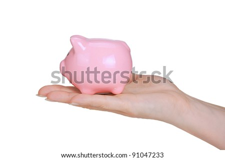 piggy bank and woman hand  isolated on white background