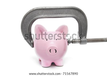 piggy bank being squeezed in a vice, on white
