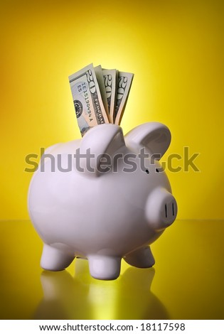 Piggy Bank Financial Investment Savings w/ Money in cash $20 bills w/ gold gradient background symbolizing retirement and investing - stock photo