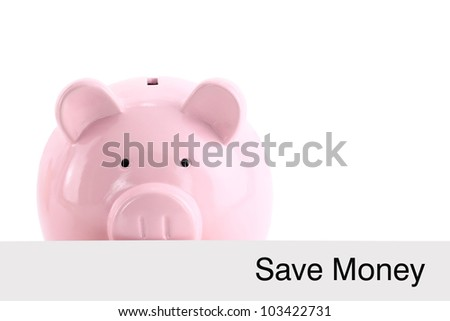 Piggy bank hiding behind a banner isolated on white