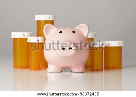 Piggy Bank In Front of Several Medicine Bottles on a Gradated Background.
