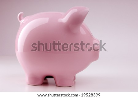 Piggy bank isolated on pink background