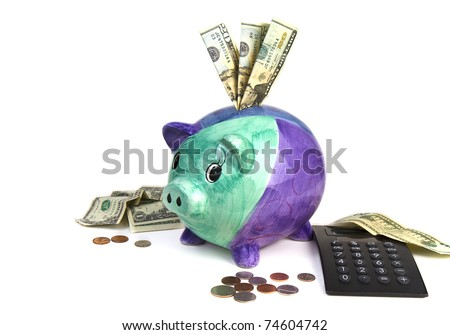 Piggy Bank, money and calculator concept of planning financially for future - stock photo