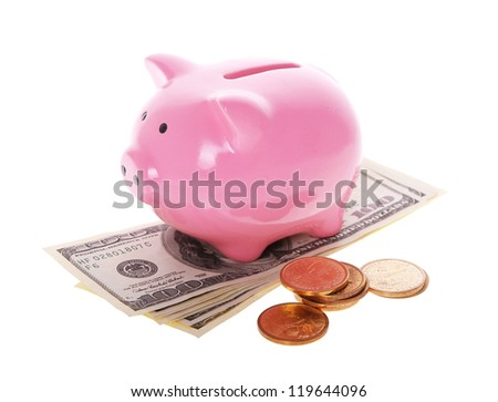 Piggy bank  money box with money and gold coins isolated on a white studio background