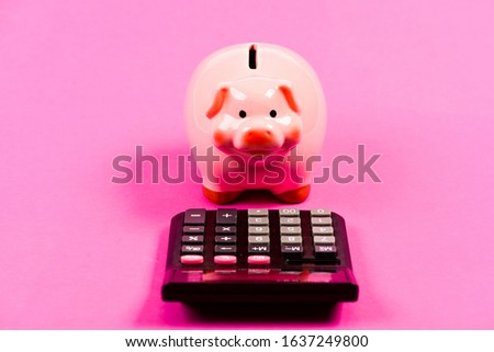 Piggy bank money savings. Investing gain profit. Pay taxes. Calculate taxes. Piggy bank pig and calculator. Taxes and charges may vary. Accounting business. Taxes and fees concept. Tax savings.