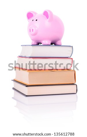 piggy bank on a stack of book concept of education costs #135612788