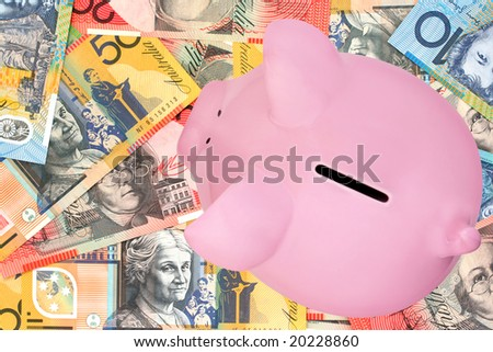 Piggy bank on Australian fifty, twenty and ten dollar notes