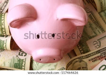 piggy bank on dollars