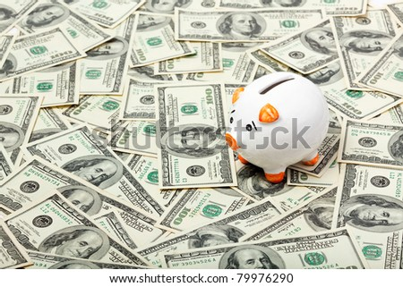 Piggy bank on dollars background