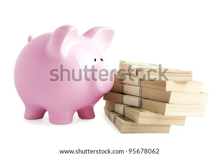 Piggy bank on dollars isolated on white background