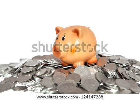 Piggy bank on pile of coins (lithuanian cents) isolated on white