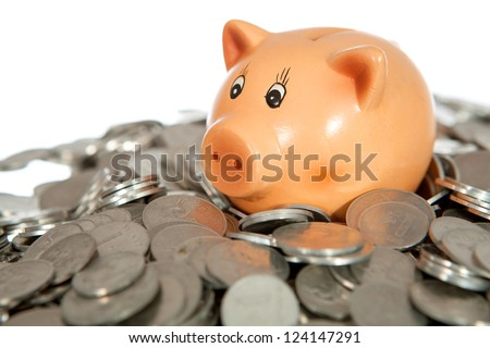 Piggy bank on pile of coins (lithuanian cents) isolated on white - stock photo