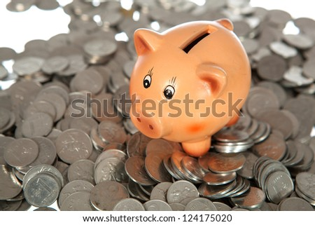 Piggy bank on pile of coins (lithuanian cents)  on white
