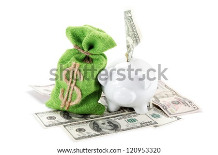 Piggy bank on the bills of American dollars isolated against white background.