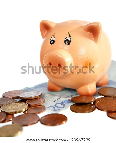 Piggy bank on twenty euro note and euro-cent coins isolated on white