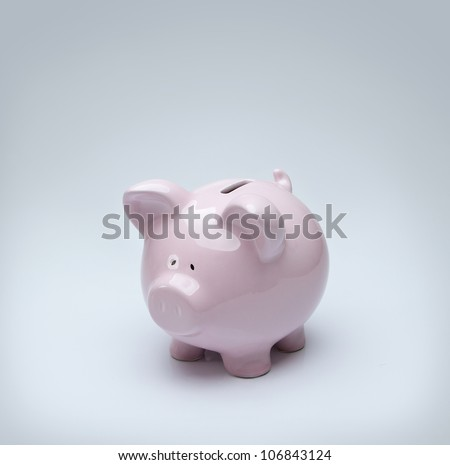 Piggy bank over gray background with copy space