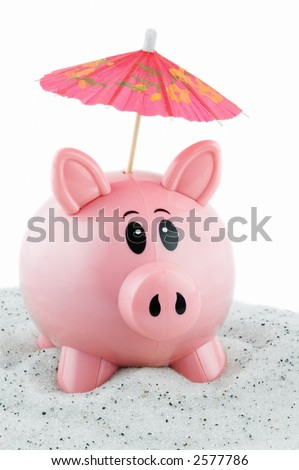 Piggy bank sits in sand with umbrella sticking out of coin slot