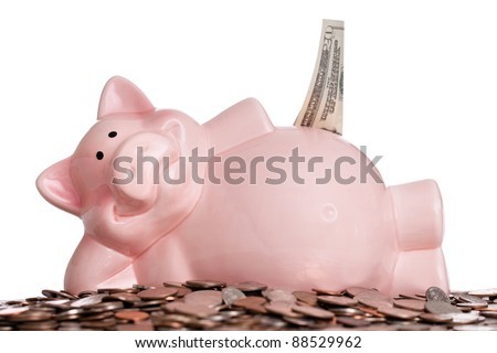 Piggy bank stuffed with money isolated on a white background
