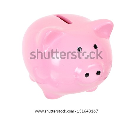 Piggy bank style money box isolated on a white studio background