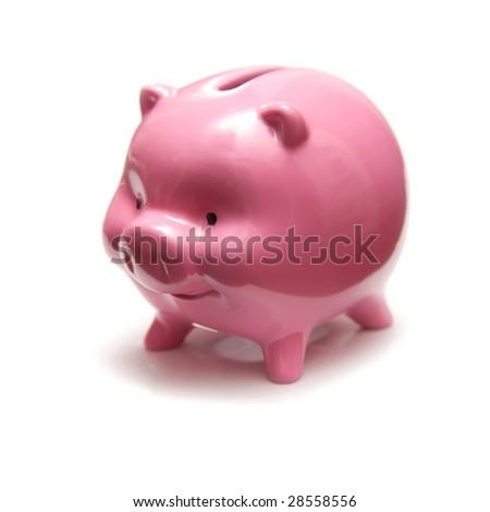 Piggy bank style money box isolated on a white studio background.