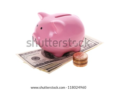 Piggy bank style money box with money isolated on a white studio background