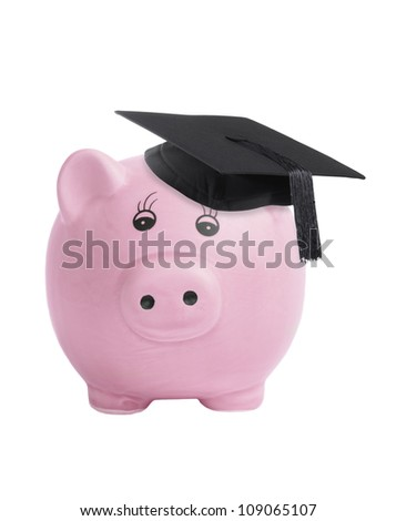 Piggy bank wearing a graduation mortar board  - saving for university concept