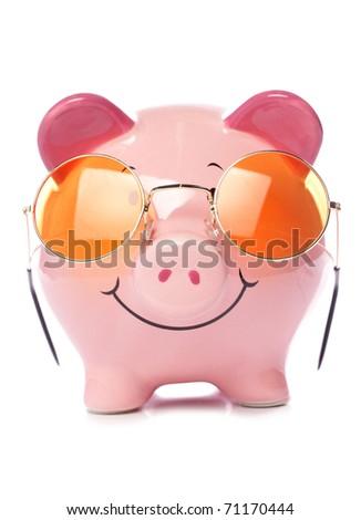 Piggy bank wearing retro sunglasses studio cutout - stock photo