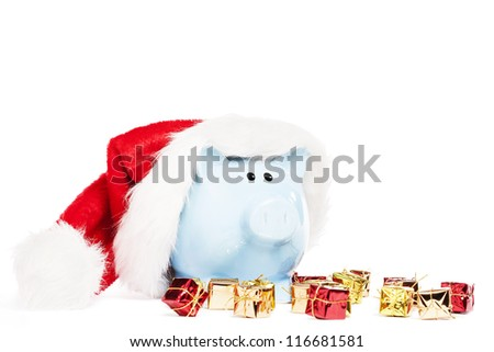 piggy bank wearing santas hat with tiny christmas presents on white background