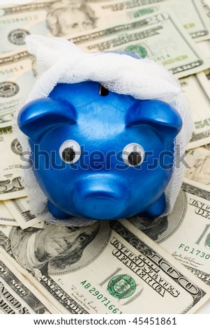 Piggy bank with a bandage over it on a money background, medication costs