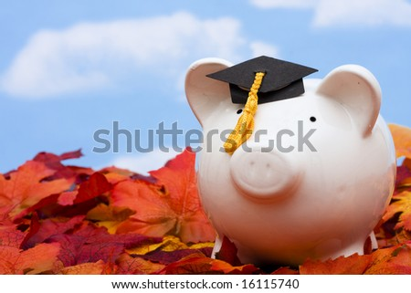 Piggy bank with a graduation cap â?? the cost of education