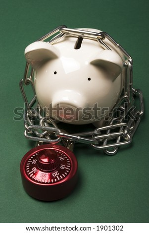 Piggy bank with a red combination lock and chain