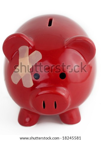 Piggy bank with band aid - stock photo
