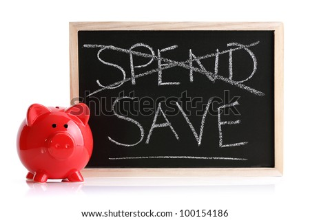 Piggy bank with blackboard and words spend and save