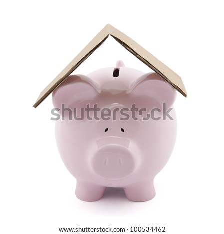 Piggy bank with cardboard roof. Clipping path included