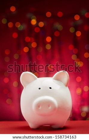 Piggy bank with Christmas lights background