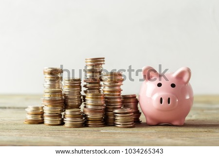 piggy bank with coin on old...