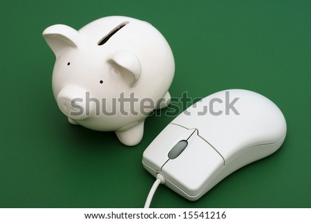Piggy bank with computer mouse on a green background