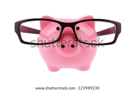 Piggy bank with glasses isolated on a white studio background