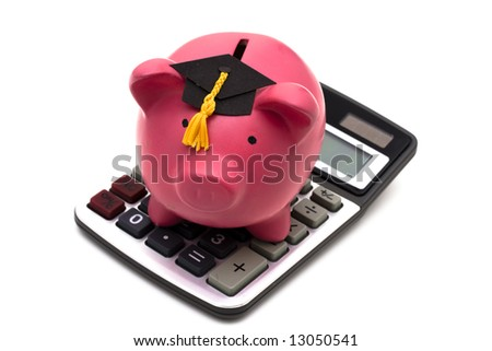 Piggy bank with graduation cap and calculator isolated on white