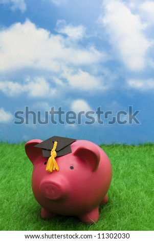 Piggy bank with graduation cap – cost of education