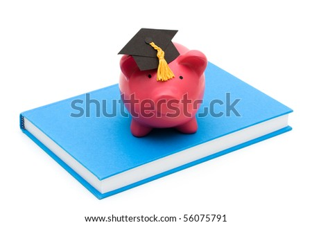 Piggy bank with graduation cap on a book isolated on a white background, education savings