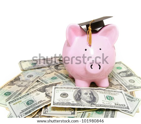 piggy bank with graduation cap, on cash