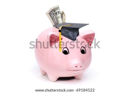 piggy bank with graduation cap on white background