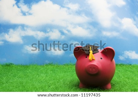 Piggy bank with graduation cap with sky background