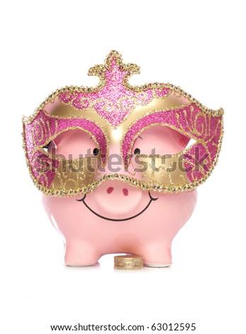 Piggy bank with masquerade party mask cutout