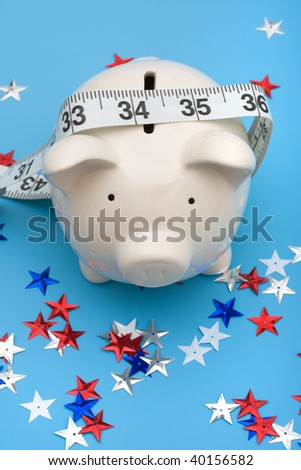 Piggy bank with measuring tape and multi colored stars making an arrow on blue background, piggy bank,