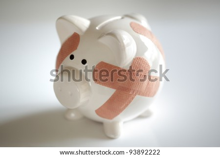 Piggy bank with plasters concept for financial crisis or economic depression