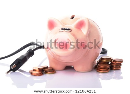 piggy bank with power plug and money on white background