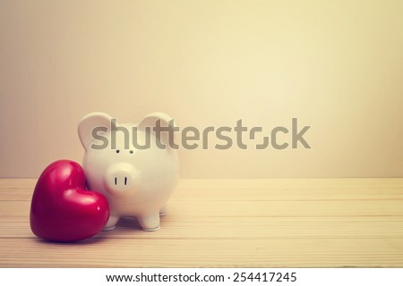 piggy bank with red heart on a...