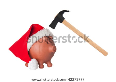 Piggy bank with Santa Claus hat and hammer isolated on white